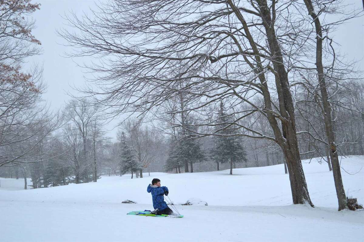 Aidan Gately, 9, of Fairfield, takes a spin at the H. Smith Richardson Golf Course, Saturday, Dec. 30, 2017, in Fairfield, Conn.