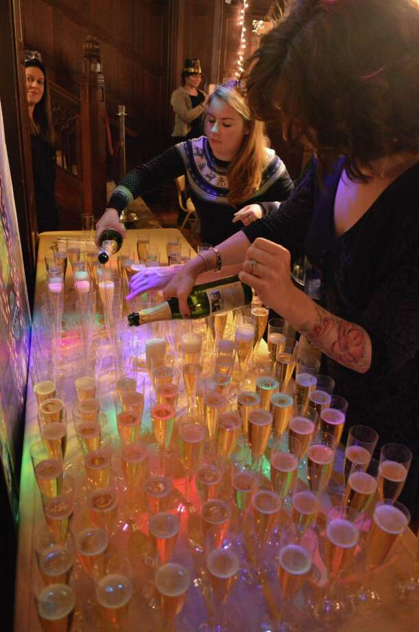 "Sparkling juice, a.k.a. ""champagne"" was poured for a ""midnight"" toast at the Recreation Department's New Year's Eve Family Fun Night at Waveny House, Sunday, Dec. 31, 2017, in New Canaan, Conn. Photo: Jarret Liotta / For Hearst Connecticut Media / New Canaan News Freelance"