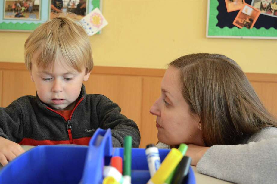 Amy Allred of Darien helps her son Brendan, 3, with his project at the Darien Library's winter craft activity, Friday, Dec. 29, 2017, in Darien, Conn. Photo: Jarret Liotta / For Hearst Connecticut Media / Darien News Freelance