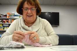 Carole Bozzi of Fairfield double-checks her work at the Purls of Wisdom Knitting and Crochet Group, held at Fairfield Woods Branch Library, Thursday, Dec. 28, 2017, in Fairfield, Conn.