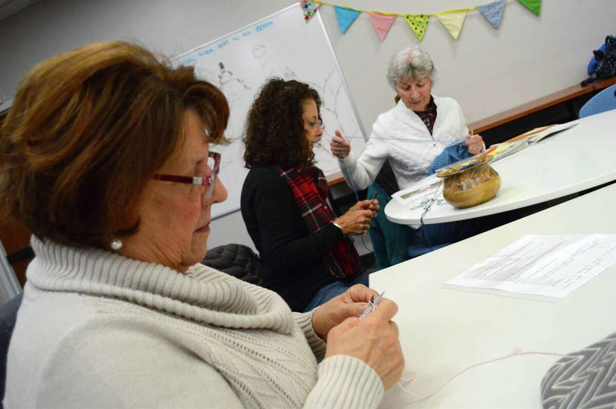 Fellow knitters, including, from left, Carole Bozzi of Fairfield, Linda Cappiello of Stratford, and Gloria Roach of Fairfield, at the Purls of Wisdom Knitting and Crochet Group, held at Fairfield Woods Branch Library, Thursday, Dec. 28, 2017, in Fairfield, Conn.