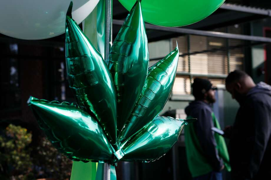 Decorations and balloons are seen outside of Harborside Health Center to celebrate the the first day of recreational marijuana sales in California on Monday, January 1, 2018 in Oakland, California. Photo: Amy Osborne, Special To The Chronicle