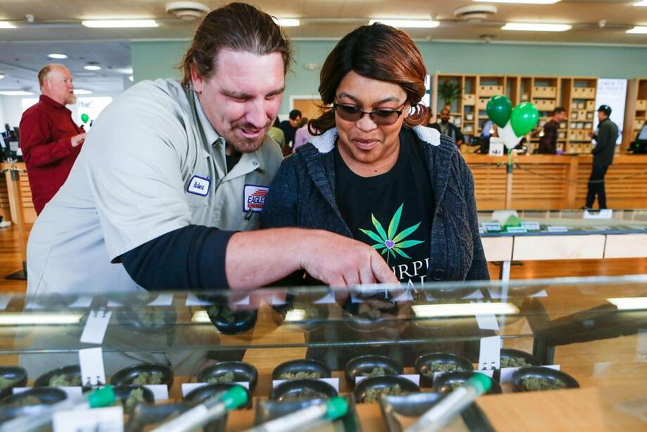 Customers Robert Thompson and Ranita Reed look over a selection of marjiuana products at Harborside Health Center on the first day of recreational marijuana sales in California on Monday, January 1, 2018 in Oakland, California. Photo: Amy Osborne, Special To The Chronicle