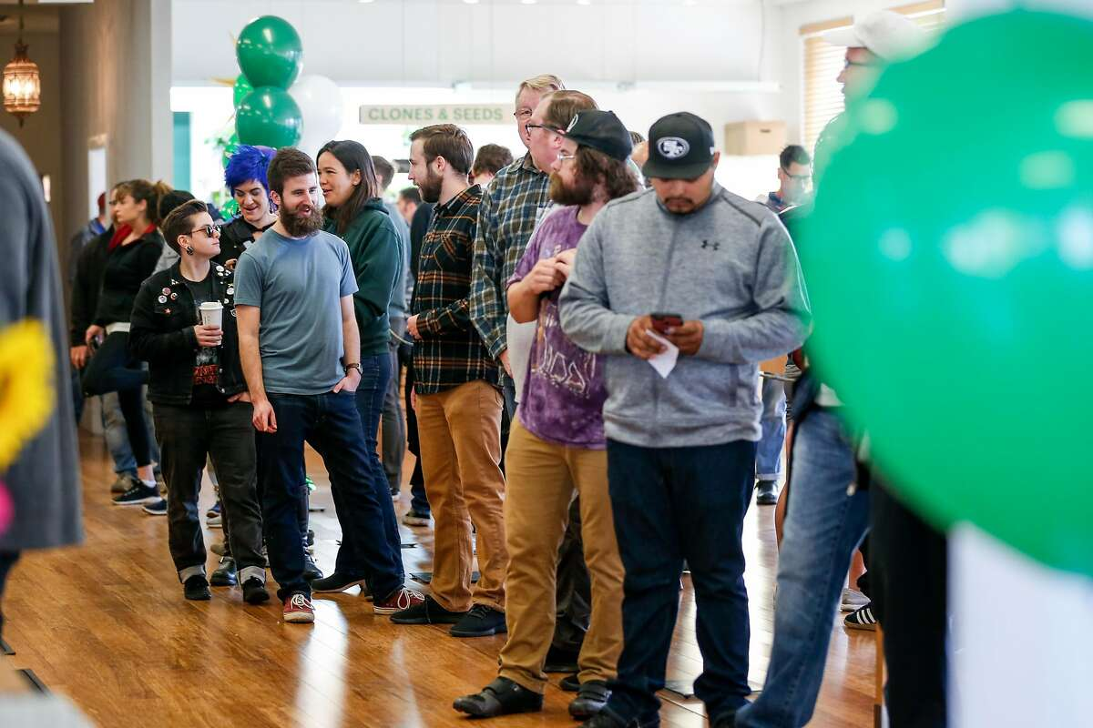 Eager customers wait in line after the opening of Harborside Health Center on the first day of recreational marijuana sales in California on Monday, January 1, 2018 in Oakland, California.