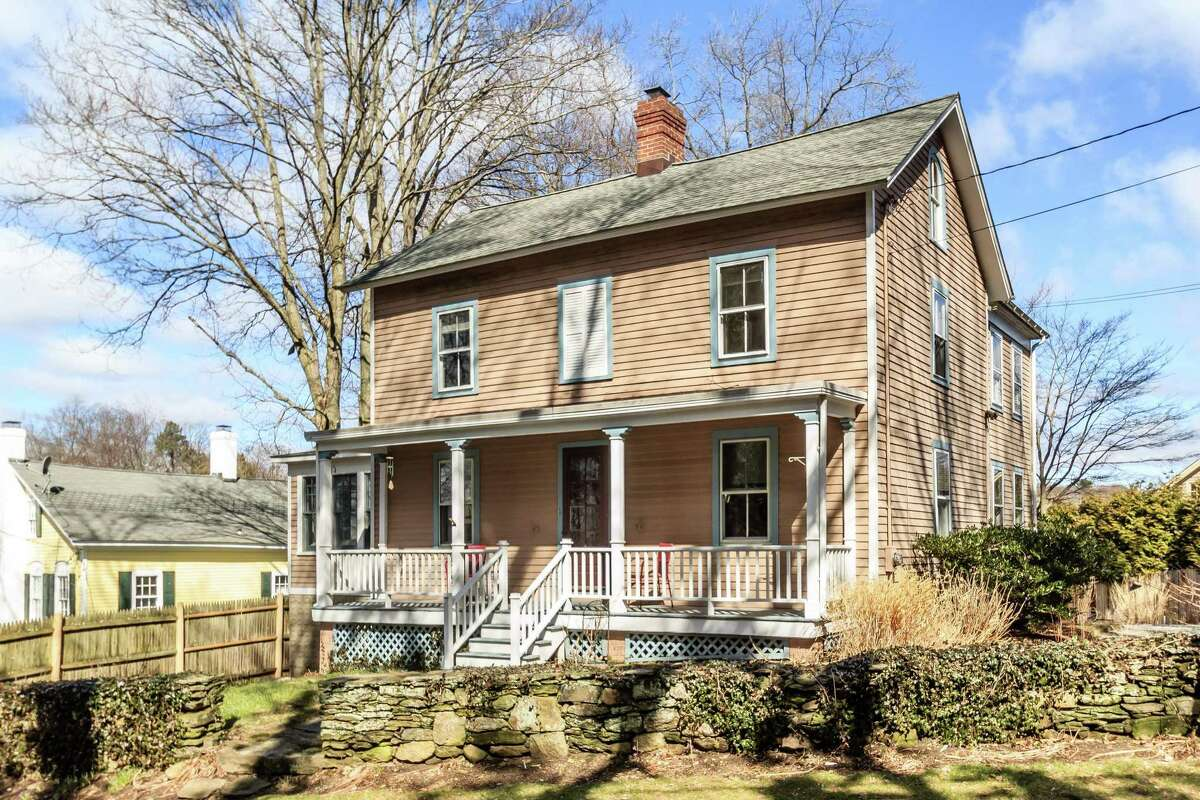 The antique colonial farmhouse at 34 Harbor Road was the home of a miller in 19th century Southport.