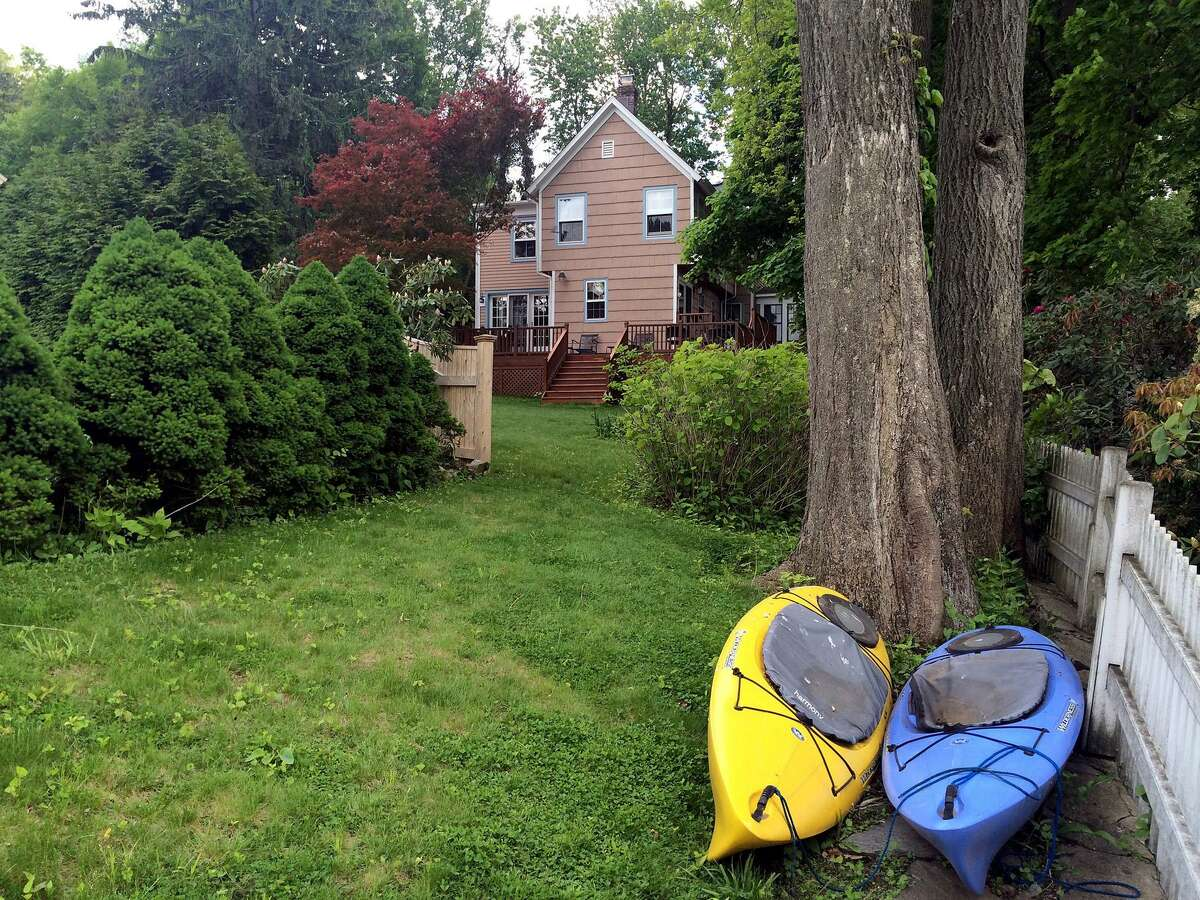 This property has access to the Mill River, and the current owners launch kayaks and canoes from their backyard.