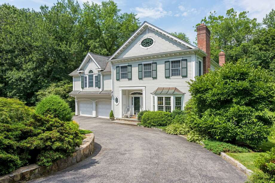 The Federal colonial house at 3 Waterbury Lane sits on a 1.13-acre level lot that enjoys much privacy, yet also is close to town.