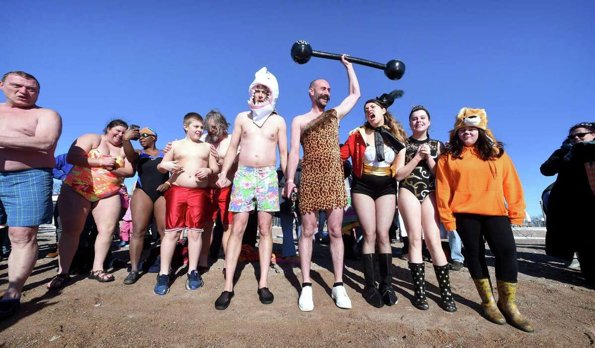 Participants brave the cold for the 2018 Plunge for Parks at Lighthouse Point Park in New Haven on January 1, 2018.
