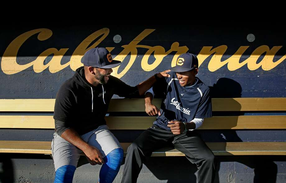 "Cal  coach Noah Jackson (left) is ""like a son"" to Dusty Baker. Cal freshman Darren Baker (right) actually is Baker's son. Photo: Michael Macor, The Chronicle"