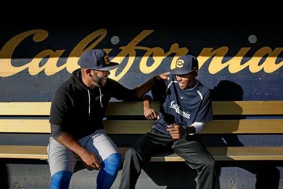 Cal Bears' Noah Jackson, (left) an assistant coach and Darren Baker an infielder at Evans Diamond, the home of the Cal baseball team in Berkeley, Calif., on Monday December 11, 2017.