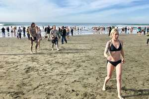 300 people showed up at the foot of Taraval Street for the annual Plunge at Ocean Beach on Monday, Jan. 1, 2018.