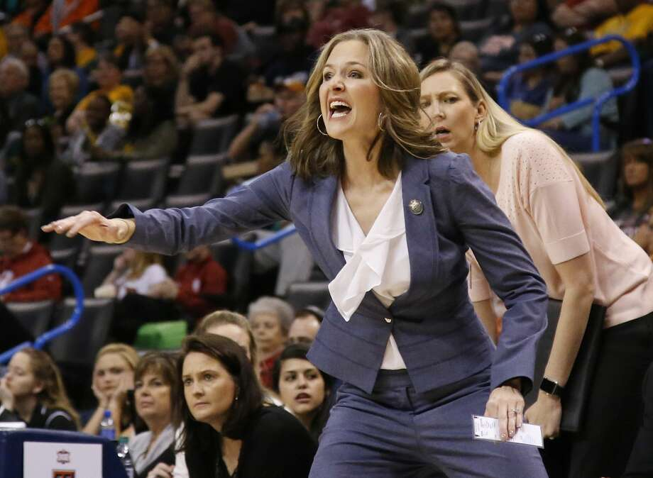 Texas Tech head coach Candi Whitaker gestures in the first quarter of an NCAA college basketball game against Baylor in the Big 12 Conference women's tournament in Oklahoma City, Saturday, March 5, 2016. (AP Photo/Sue Ogrocki) Photo: Sue Ogrocki/AP