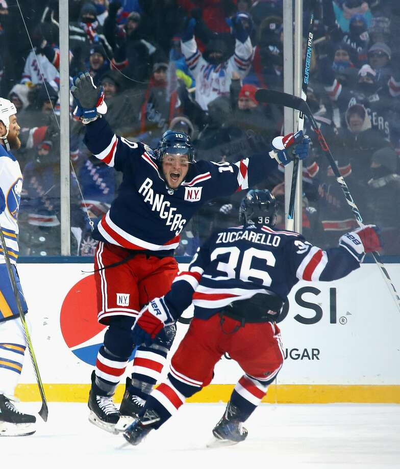 The Rangers' J.T. Miller celebrates his overtime goal with Mats Zuccarello. Photo: Bruce Bennett, Getty Images