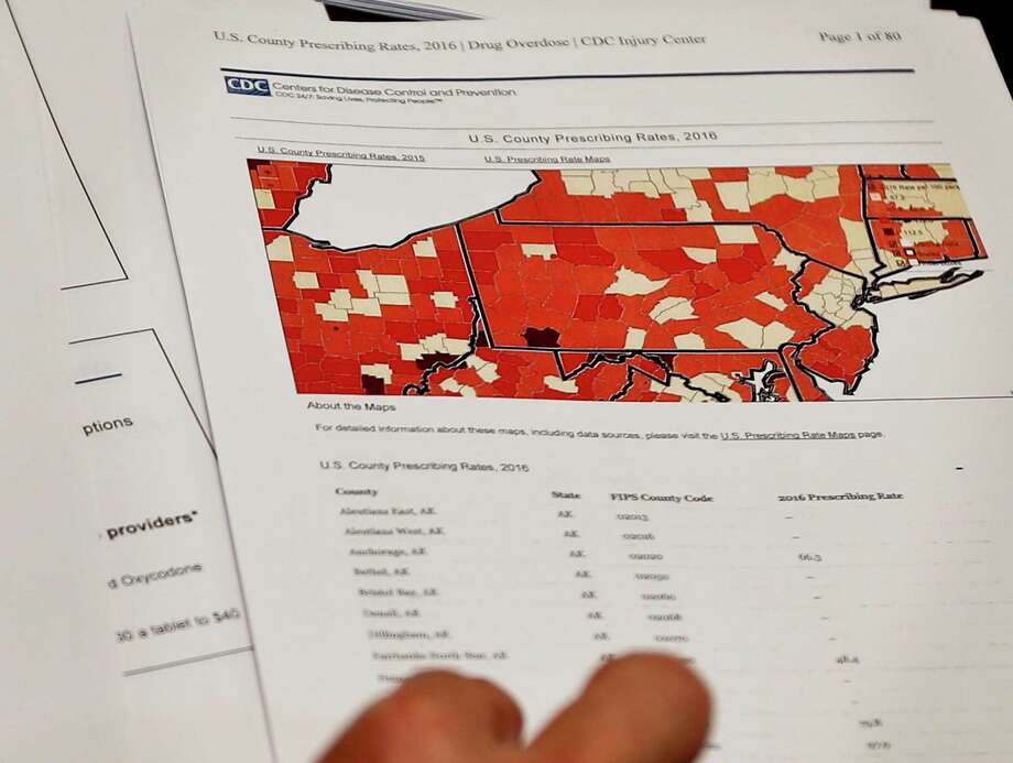 Assistant U.S. Attorney Robert Cessar shows a map illustrating the rates of opioid prescriptions by county in Pittsburgh. The Justice Department hopes this data will help combat drug abuse. Photo: Keith Srakocic, STF / Copyright 2017 The Associated Press. All rights reserved.