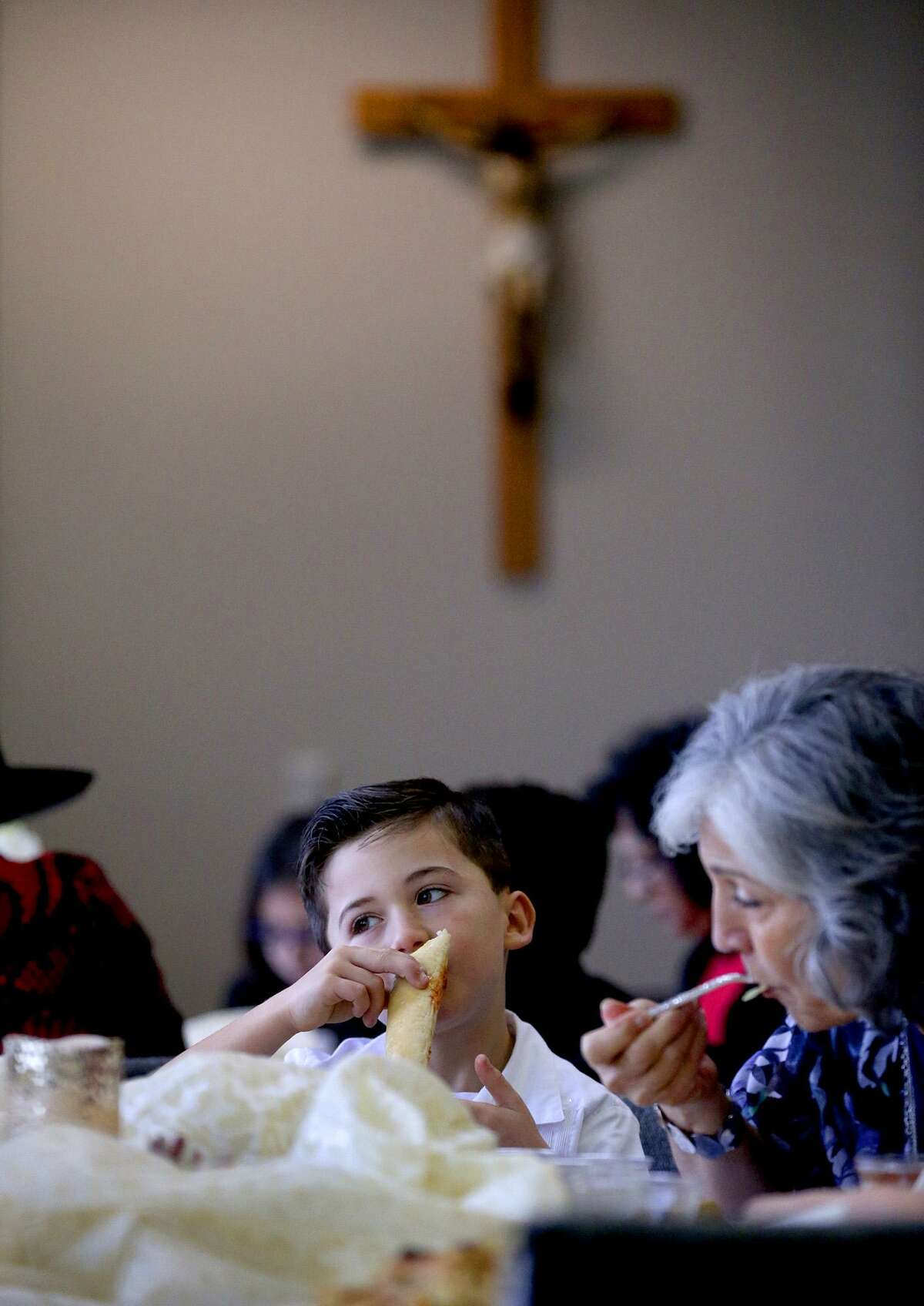 """Paul Chavez, 7, has lunch Monday during the New Year's Day """"Celebration of Hope."""" On the right is Mercedes Bristol."""