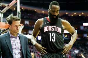 James Harden heads to the locker room near the end of the fourth quarter Sunday night with a strained right hamstring that kept him from returning for the two overtimes in a win over the Lakers.