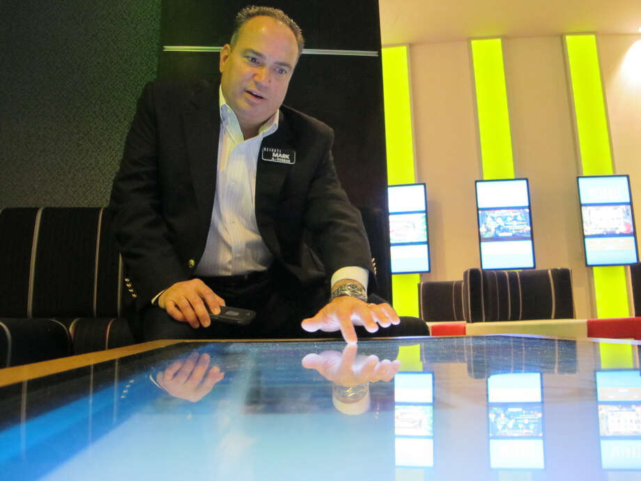 """FILE - In an April 15, 2015 file photo, Mark Giannantonio, president of Resorts Casino Hotel in Atlantic City N.J. demonstrates a tabletop internet gambling console at his casino. """"I'm extremely optimistic about Atlantic City and the industry in 2018."""" """"We're very excited about the renaissance of Atlantic City; we think it's for real,"""" said Giannantonio, president of Resorts, which was the first U.S. casino to open outside Nevada and will celebrate its 40th anniversary in May.  (AP Photo/Wayne Parry, File) Photo: Wayne Parry / Copyright 2016 The Associated Press. All rights reserved."""