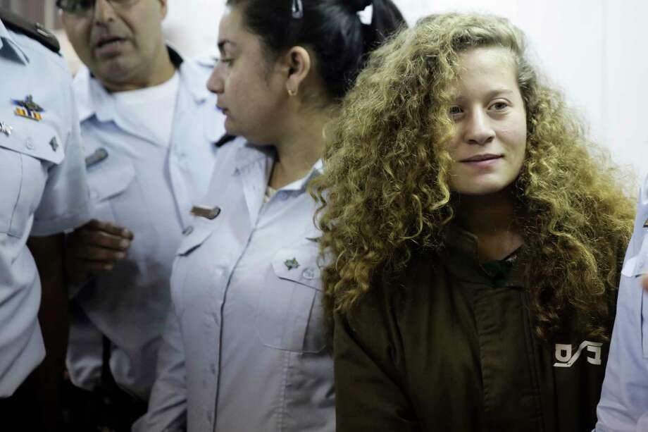 Ahed Tamimi is brought to a courtroom inside Ofer military prison near Jerusalem. Tamimi was indicted for attacking the soldiers and previous altercations.  Photo: Mahmoud Illean, STR / Copyright 2018 The Associated Press. All rights reserved.