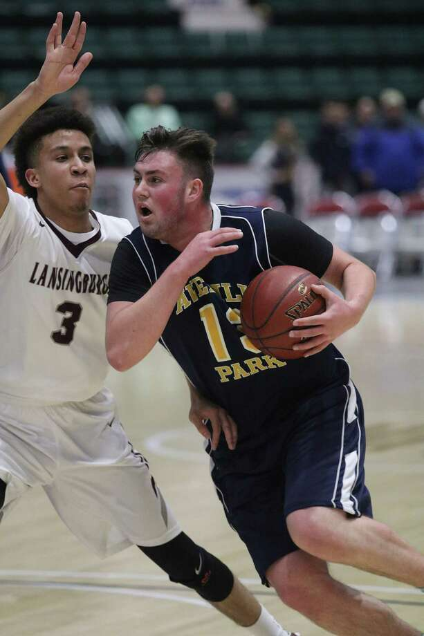 Averill Park's Anthony Germanerio moves the ball past Lansingburgh defender Jio Canty during the Section II Class A boys' basketball final at the Glens Falls Civic Center Saturday, March 4, 2017. (Ed Burke-Special to The Times Union)