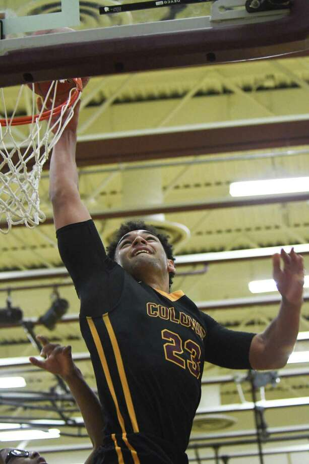 Colonie's Isaiah Moll dunks the ball during the final game of the Harold Sand Holiday Basketball Challenge against Watervliet on Friday, Dec. 29, 2017, in Colonie, N.Y. Colonie defeated Watervliet 65-53. (Jenn March/Special to the Times Union) Photo: Jenn March / © Jenn March 2017-18 © Albany Times Union 2017-18