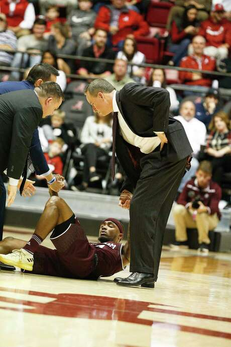 A&M and coach Billy Kennedy, right, are likely to be without guard Duane Wilson against Florida on Tues-day after he suffered a knee injury against Alabama. Photo: Brynn Anderson, STF / Copyright 2017 The Associated Press. All rights reserved.