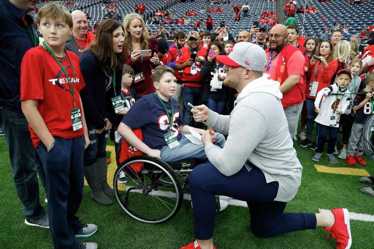 Houston Texans defensive end J.J. Watt stops to chat with Seth Haynes, 13, of Kingwood, before the start of an NFL football game at NRG Stadium, Sunday, Dec. 10, 2017, in Houston. ( Karen Warren / Houston Chronicle )