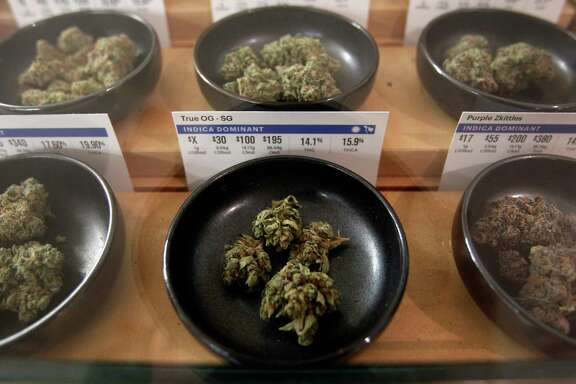Different types of marijuana sit on display at Harborside marijuana dispensary, Monday, Jan. 1, 2018, in Oakland, Calif. Starting New Year's Day, recreational marijuana can be sold legally in California. (AP Photo/Mathew Sumner)
