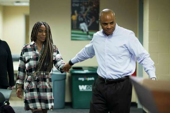 """Texans executive vice president Rick Smith gives his wife, Tiffany, a more prominent position at Monday's news  conference to show """"how healthy she is."""""""