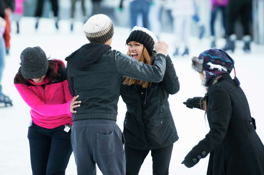 Young skaters try to dance to the music of Luis Fonsi at The ICE at Discovery Green, Monday, Jan. 1, 2018, in Houston. Photo: Marie D. De Jesus, Houston Chronicle / © 2018 Houston Chronicle