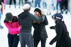 Young skaters try to dance to the music of Luis Fonsi at The ICE at Discovery Green, Monday, Jan. 1, 2018, in Houston.