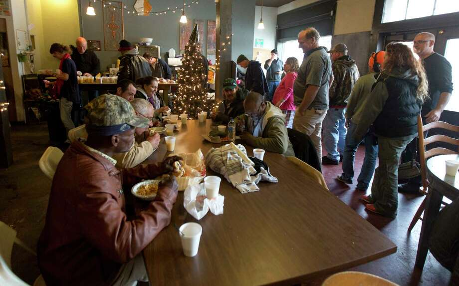 Worshipers at Conroe House of Prayer enjoy breakfast after a service, Monday, Jan. 1, 2018, in Conroe. The worship center extended its hours through the late afternoon Monday to serve as a warm place for the homless to stay because of the freezing weather. Photo: Jason Fochtman, Staff Photographer / © 2017 Houston Chronicle