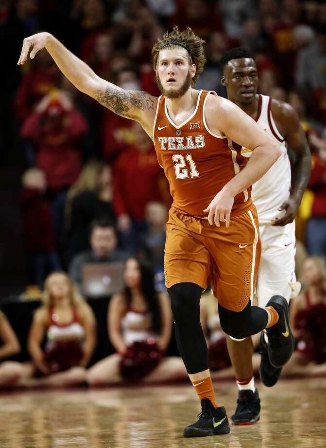 Texas forward Dylan Osetkowski (21) celebrates in front of Iowa State forward Cameron Lard, right, after making 3-point basket at the end of an NCAA college basketball game, Monday, Jan. 1, 2018, in Ames, Iowa. Osetkowski scored 25 points as Texas won 74-70 in overtime. (AP Photo/Charlie Neibergall) Photo: Charlie Neibergall/Associated Press