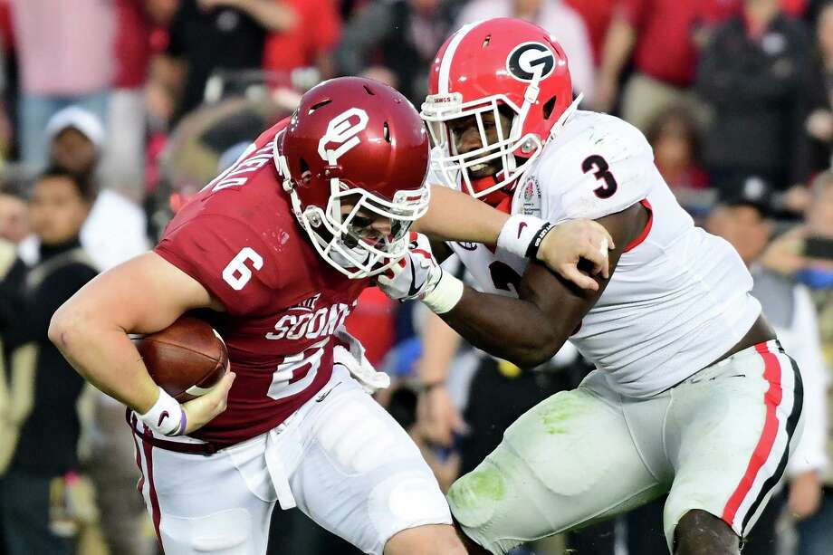 PASADENA, CA - JANUARY 01:  Quarterback Baker Mayfield #6 of the Oklahoma Sooners looks to avoid a sack by linebacker Roquan Smith #3 of the Georgia Bulldogs in the second half in the 2018 College Football Playoff Semifinal at the Rose Bowl Game presented by Northwestern Mutual at the Rose Bowl on January 1, 2018 in Pasadena, California.  (Photo by Harry How/Getty Images) Photo: Harry How, Staff / 2018 Getty Images