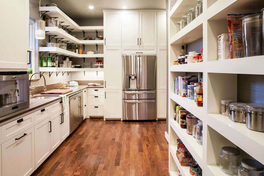 Chairma Design Group created this super pantry with extra appliances, plenty of shelving and work space, too. Photo: Courtesy Of Chairma Design Group