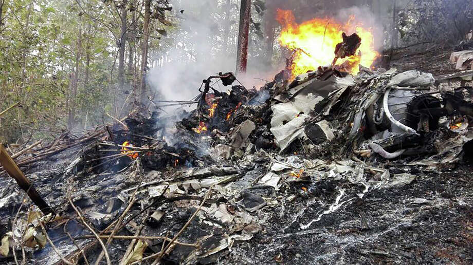 Handout picture released by Costa Rica's Public Security Ministry showing the fuselage of a small plane that crashed in Corozalito near Punta Islita, in the Costa Rican Pacific province of Guanacaste, still burning after it went down on December 31, 2017. 