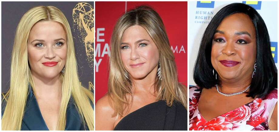 "FILE- This combination of file photos show actresses Reese Witherspoon at the 69th Primetime Emmy Awards in Los Angeles, left, Jennifer Aniston at a screening of ""Office Christmas Party"" in New York and Shonda Rhimes at the 2015 Human Rights Campaign Gala Dinner in Los Angeles. Witherspoon, Rhimes and Aniston are among hundreds of Hollywood women who have formed an anti-harassment coalition called Time's Up. (AP Photo/File) / Copyright 2018 The Associated Press. All rights reserved."