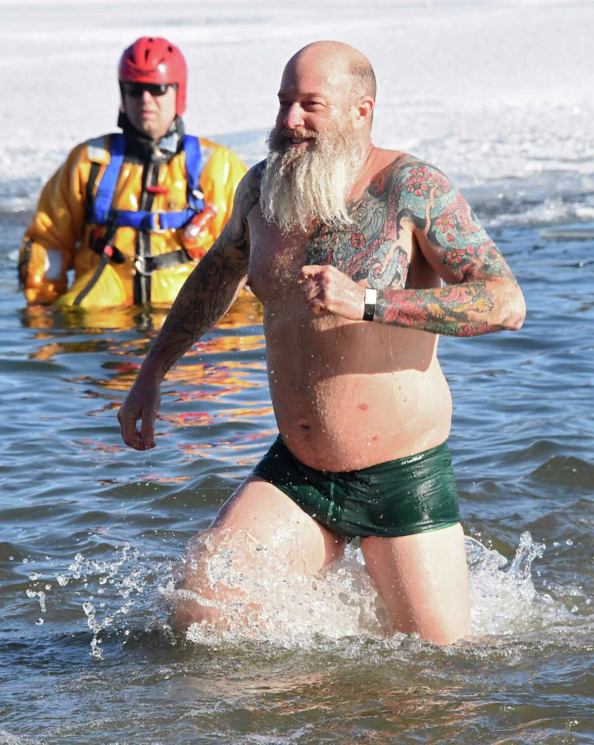 John Lawrence of Clifton Park braves the bitter cold and participates in the annual Polar Plunge at Shepard Park Beach on Monday, Jan. 1, 2018 in Lake George, N.Y. (Lori Van Buren / Times Union)