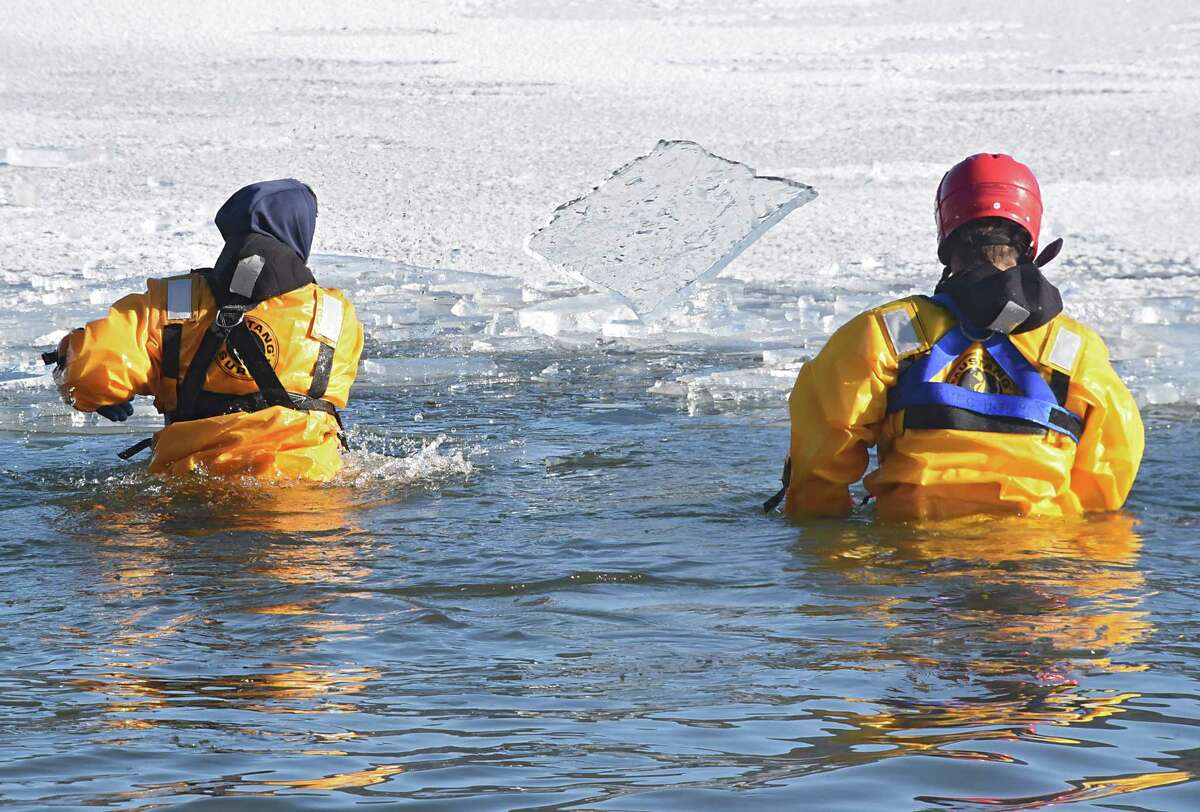 Members of the Lake George Fire Department remove a large sheet of ice from the swimming area during the annual Polar Plunge at Shepard Park Beach on Monday, Jan. 1, 2018 in Lake George, N.Y. (Lori Van Buren / Times Union)