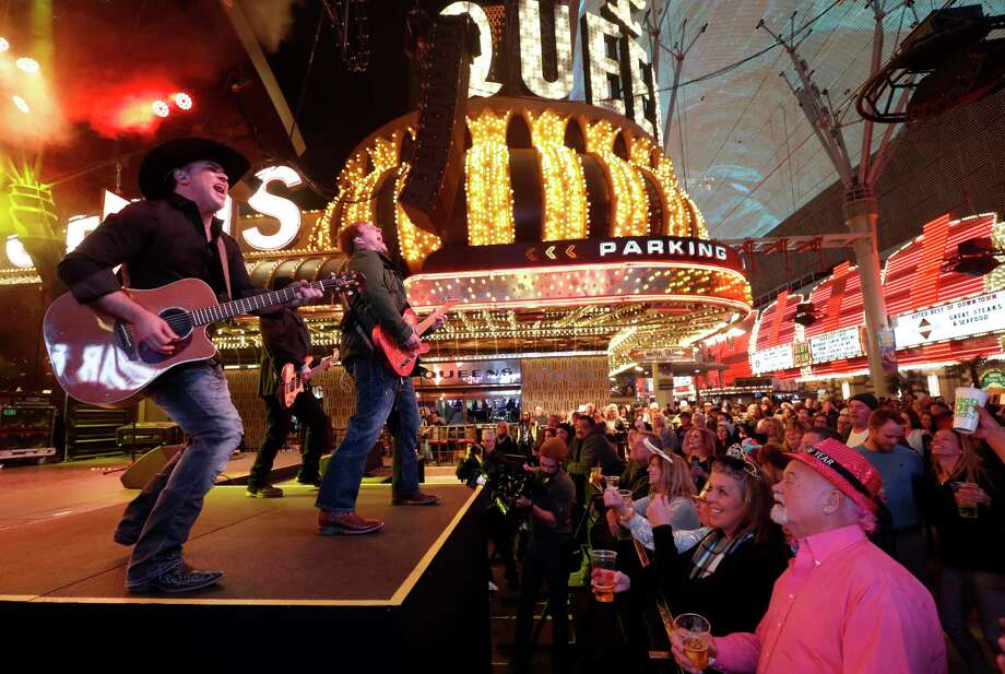 The Tony Marques Band performs on the Third Street Stage during New Year's Eve celebrations at the Fremont Street Experience in downtown Las Vegas, Sunday, Dec. 31, 2017. (Steve Marcus/Las Vegas Sun via AP) Photo: Steve Marcus / LAS VEGAS SUN
