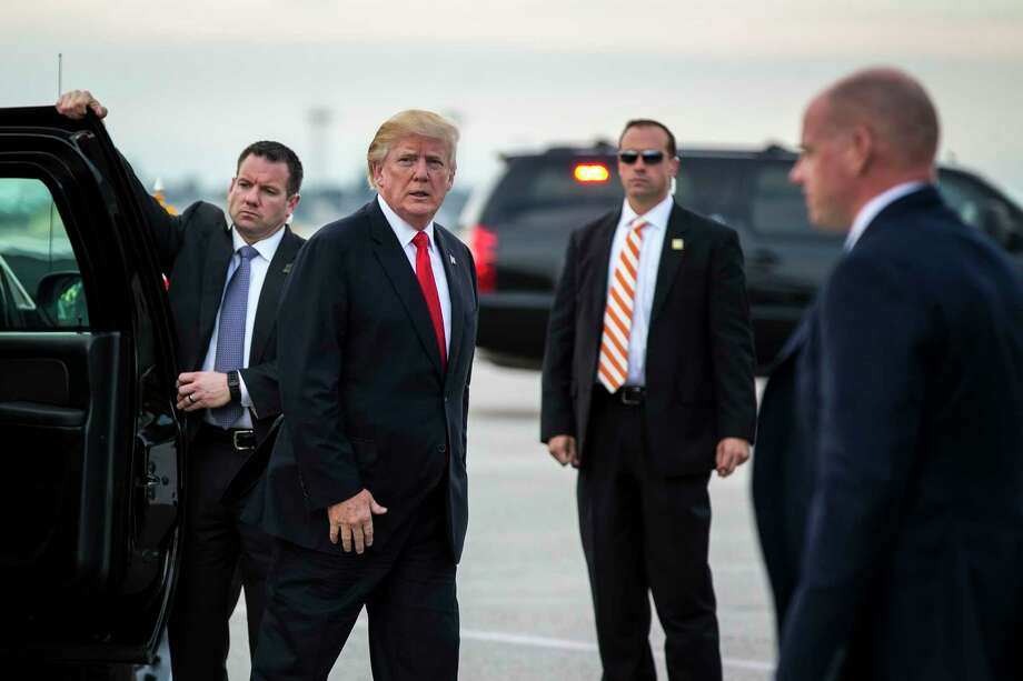 President Donald Trump prepares to board Air Force One to head back to Washington, at Palm Beach International Airport in West Palm Beach, Fla., Jan. 1, 2018. (Al Drago/The New York Times Photo: AL DRAGO / NYTNS