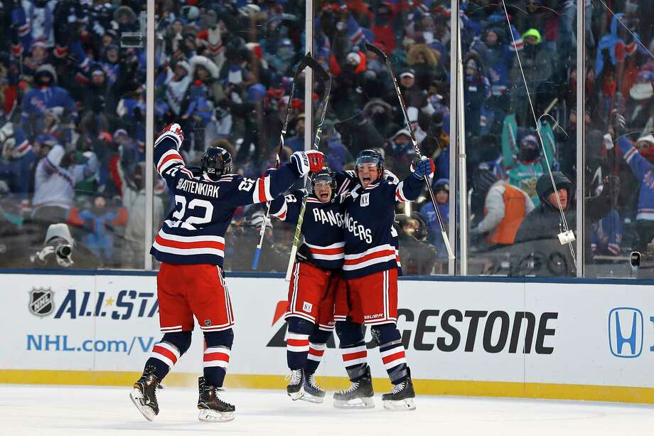 New York Rangers left wing J.T. Miller (10) celebrates scoring the game winning goal with Rangers right wing Mats Zuccarello (36) and Rangers defenseman Kevin Shattenkirk (22) against the Buffalo Sabres in overtime of the NHL Winter Classic hockey game at CitiField in New York on Monday, Jan. 1, 2018. The Rangers won 3-2. (AP Photo/Adam Hunger) Photo: Adam Hunger / FR110666 AP