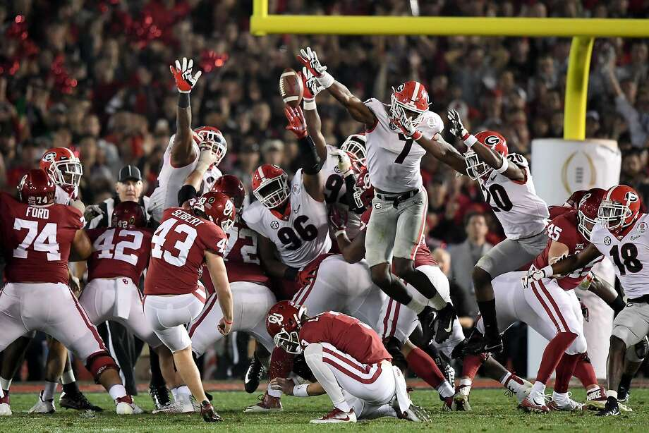 Georgia's Lorenzo Carter (7) blocks the field-goal try by Oklahoma's Austin Seibert in the second overtime in the Rose Bowl. Photo: Kevork Djansezian, Getty Images
