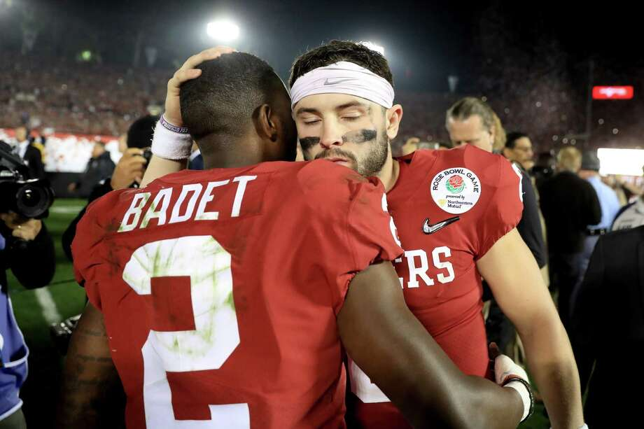 """Baker Mayfield, right, said of the end of his college career, """"It's been a wild ride."""" Photo: Sean M. Haffey, Staff / 2018 Getty Images"""