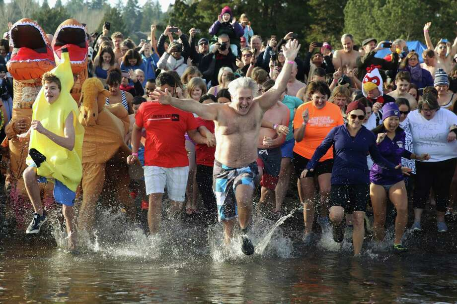 Hundreds of brave souls participate in the 16th annual Matthew's Beach Polar Plunge, Monday, Jan. 1, 2018. Photo: GENNA MARTIN, SEATTLEPI.COM / Seattlepi.com