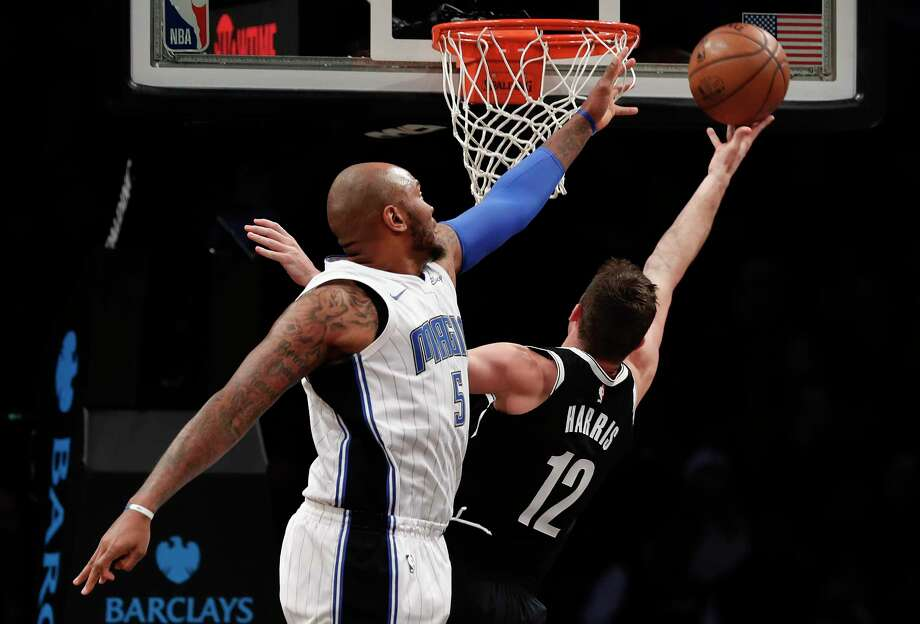 Brooklyn Nets guard Joe Harris (12) puts up a shot against Orlando Magic forward Marreese Speights (5) during the second quarter of an NBA basketball game, Monday, Jan. 1, 2018, in New York. (AP Photo/Julie Jacobson) Photo: Julie Jacobson / Copyright 2018 The Associated Press. All rights reserved.