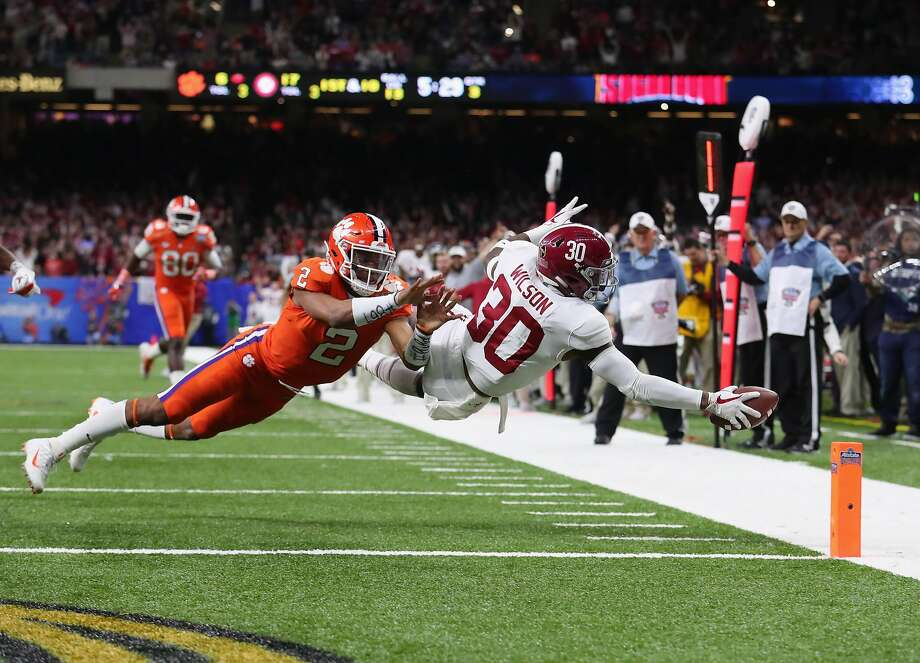 Alabama's Mack Wilson scores on an interception as Clemson's Kelly Bryant tries to stop him. Photo: Tom Pennington, Getty Images