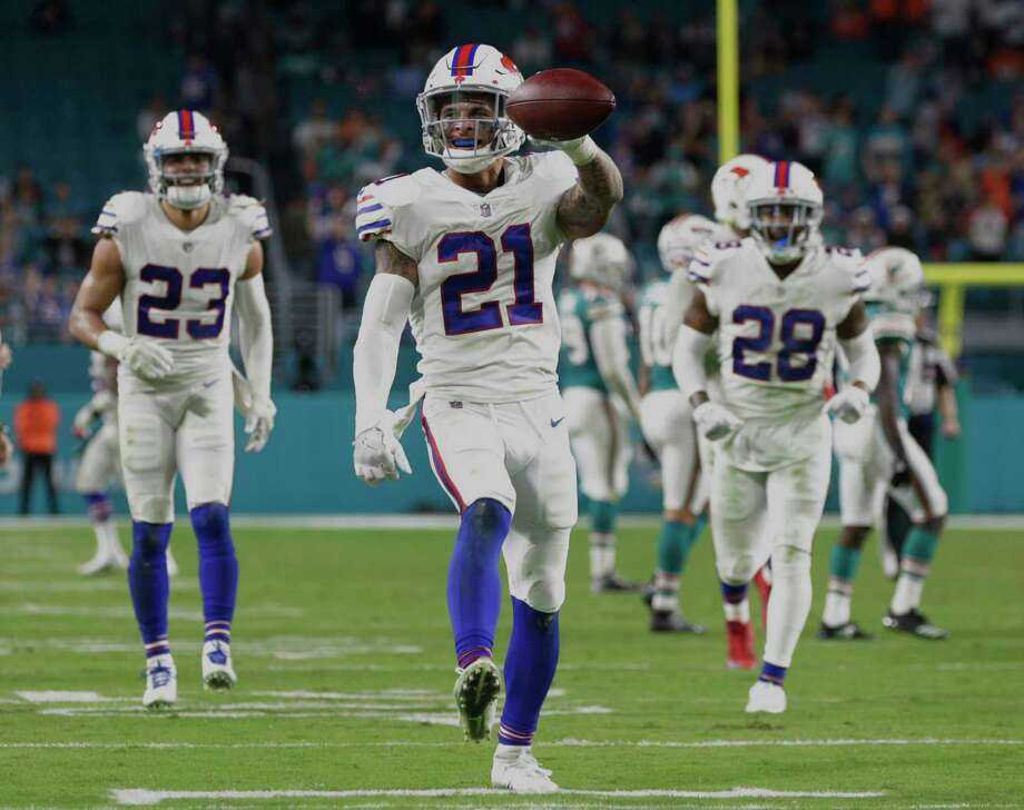 Buffalo Bills free safety Jordan Poyer (21) shows the ball after he intercepted a pass late in the second half of an NFL football game against the Miami Dolphins, Sunday, Dec. 31, 2017, in Miami Gardens, Fla. The Bills defeated the Dolphins 22-16. (AP Photo/Lynne Sladky) Photo: Lynne Sladky / Copyright 2017 The Associated Press. All rights reserved.
