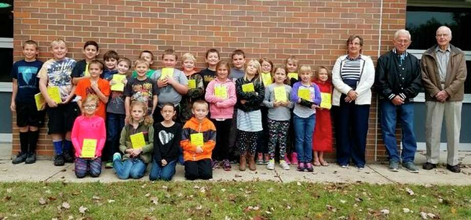 Studley Grange members present dictionaries to third graders at Floyd Elementary School. (Photo provided)