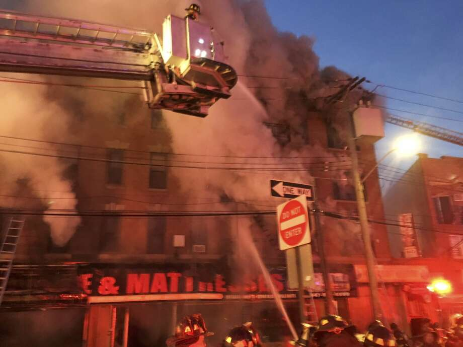 In this photo provided by the FDNY, firefighters battle a blaze at a building in the Bronx borough of New York, Tuesday, Jan. 2, 2018. (FDNY via AP) Photo: AP