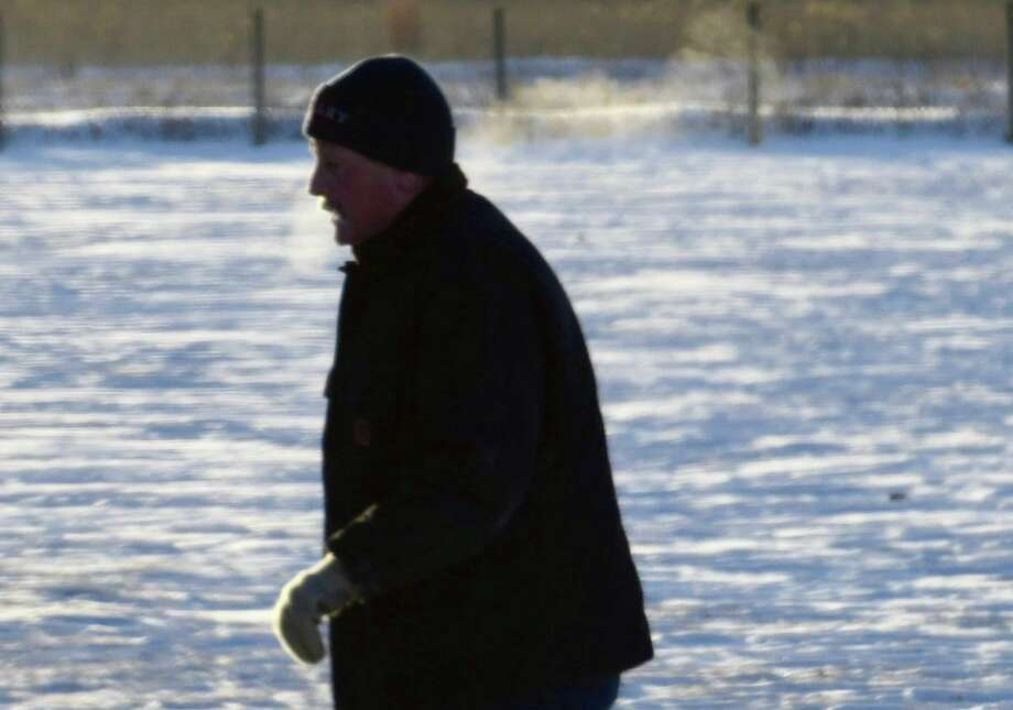 A man braves the extreme cold Tuesday to get in some morning exercise in Colonie.  Photo: Skip Dickstein / Times Union